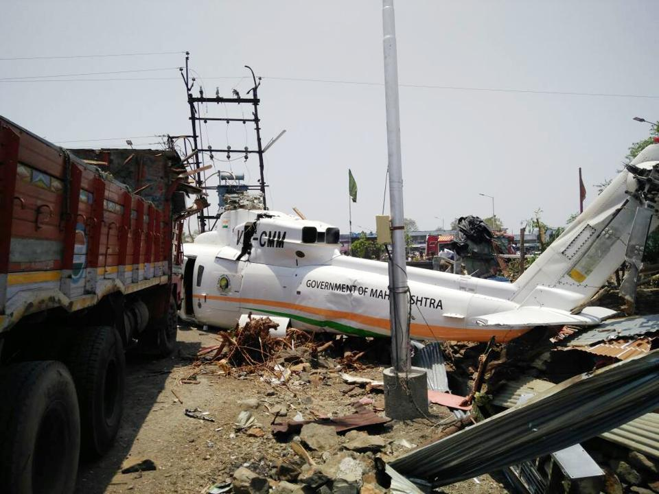 """The chopper after it crash-landed at Latur on Thursday. The pilot encountered """"variable wind pattern"""" after taking off and decided to turn the government-owned Sikorsky helicopter around just as it had reached 80 feet. However, while landing, the chopper got entangled in electricity wires and came crashing down."""