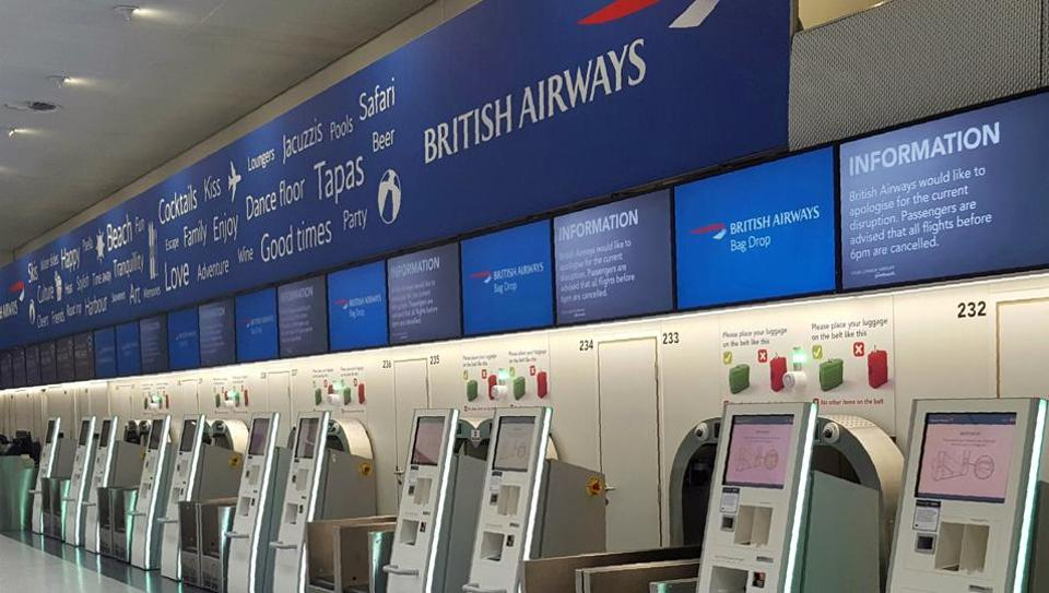 A view of the empty British Airways check-in desk after an IT systems failure at London's Gatwick Airport on Saturday, May 27. British Airways cancelled all flights from London's Heathrow and Gatwick airports.