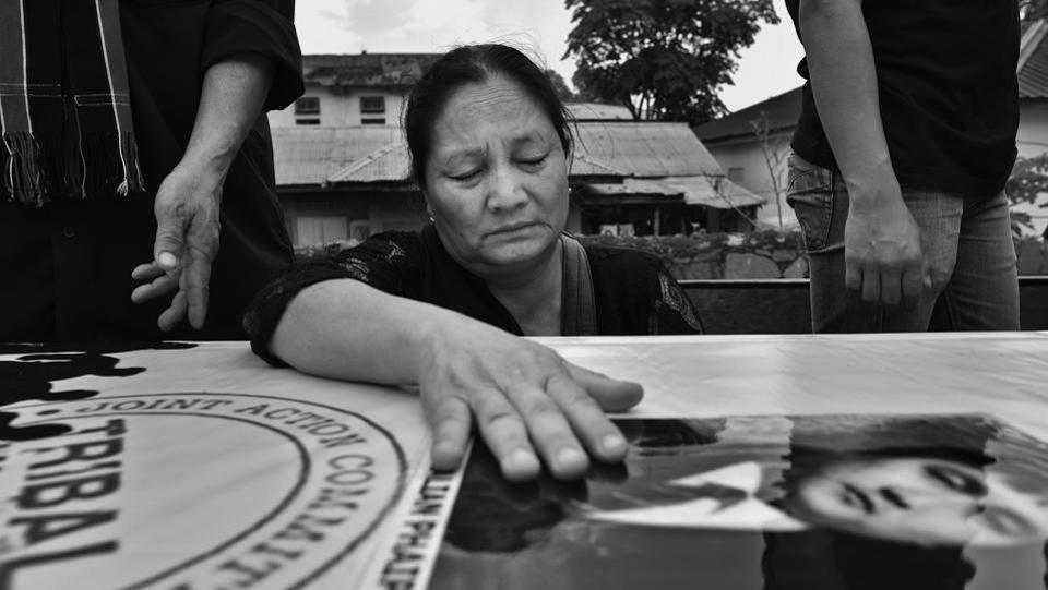 Mother of Thangzalian Phaipi, a victim of the firing, mourns next to his coffin. The protests, in which the 9 lost their lives, were triggered after the Manipur government passed three bills, which were viewed as an act of aggression by the people of the valley, the Meiteis, who saw them as an onslaught on their living and land rights as well as their identity.  (Ravi Choudhary/HT PHOTO)
