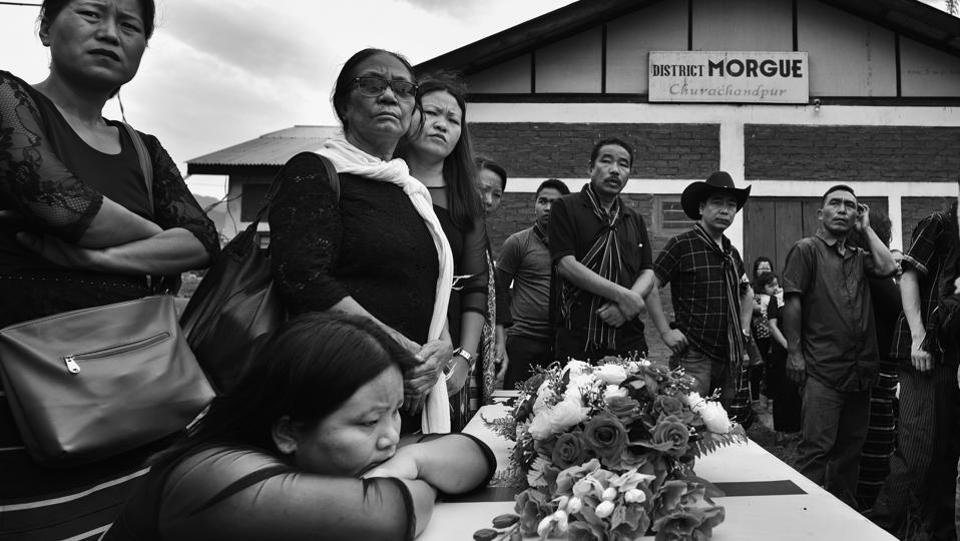Family members of Robert V Jamminthang gather around his coffin. After the violence and the killing, the town refused to bury its dead as an act of protest, in an attempt to force the government to agree to their demands.  (Ravi Choudhary/HT PHOTO)