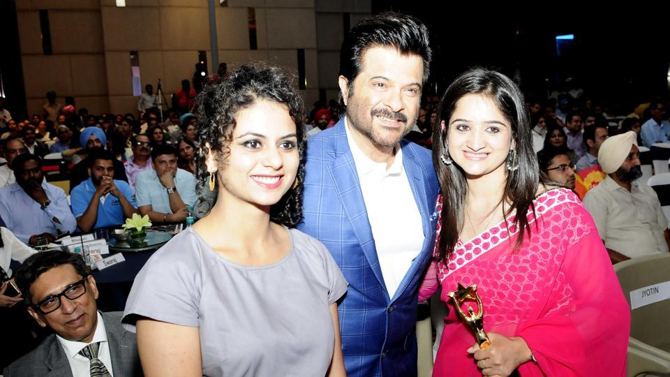 Artist Manjot Kaur (L), Bollywood actor Anil Kapoor, and youngest BDC chairperson Prajwal Bushta at HT Youth Forum in Chandigarh on Friday (Keshav Singh/HT Photo)