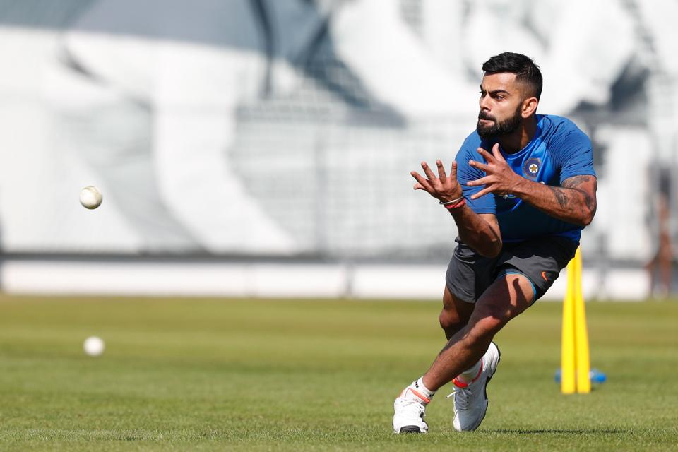 India's Virat Kohli takes a catch during a practice session at Lord's Cricket Ground in London. (AFP)