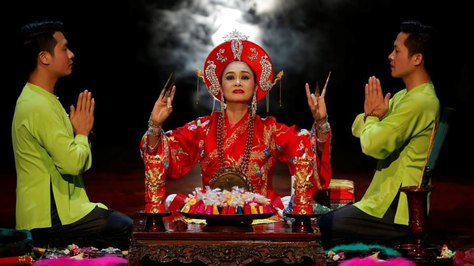 Medium An Chinh (C), is seen during a Hau Dong performance at the Viet Theatre in Hanoi, Vietnam. Dating to the 16th century, Hau Dong centres on a belief in the Mother Goddesses of three realms - forest, water and heaven. (Kham/REUTERS)