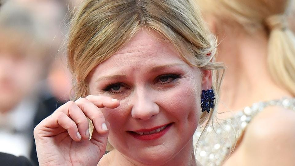Kirsten Dunst cries as she arrives on for the screening of the film The Beguiled at the 70th edition of the Cannes Film Festival in Cannes.