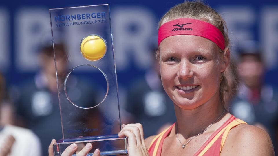 Kiki Bertens of the Netherlands poses with the trophy after defeating Czech player Barbora Krejcikova.