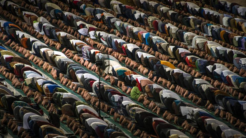 Indonesian Muslims pray during the start of the holy month of Ramadan at the Al Akbar mosque in Surabaya. More than 1.5 billion Muslims around the world will mark the month, during which believers abstain from eating, drinking, and smoking from dawn until sunset.  (Juni Kriswanto/AFP)