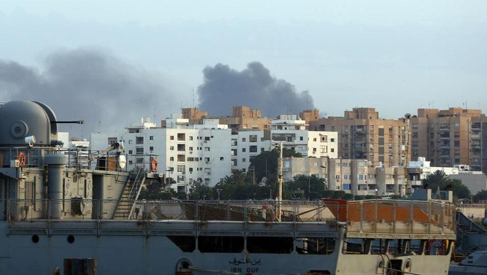 Smoke rises in the centre of the Libyan capital of Tripoli after clashes.