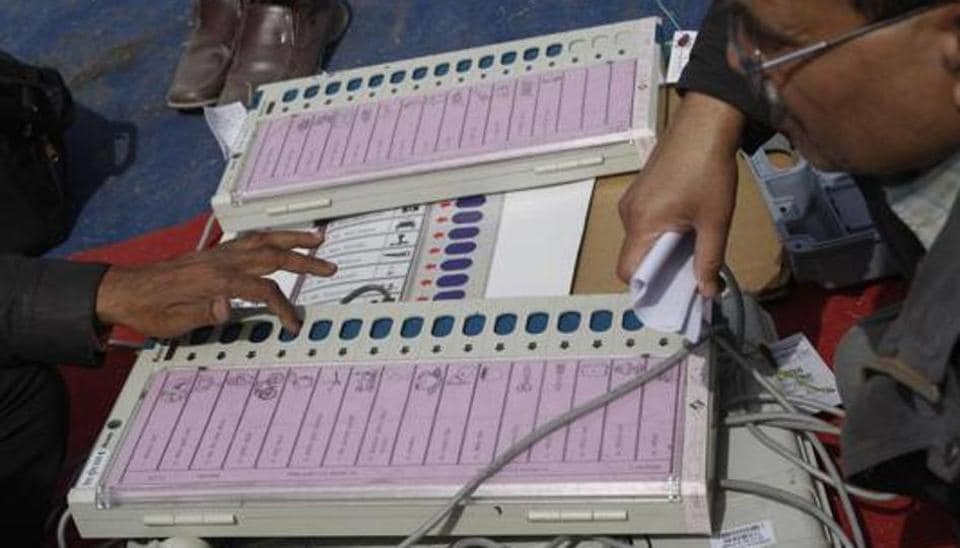 Polling officers checking electronic voting machines (EVM) at an EVM distribution centre in Noida on February 27, 2012.