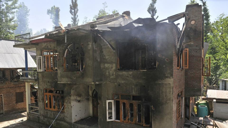 A damaged house where Sabzar Ahmad Bhat, head of the Hizbul Mujahideen militant group, was killed in an overnight gunfight in Kashmir's Tral.