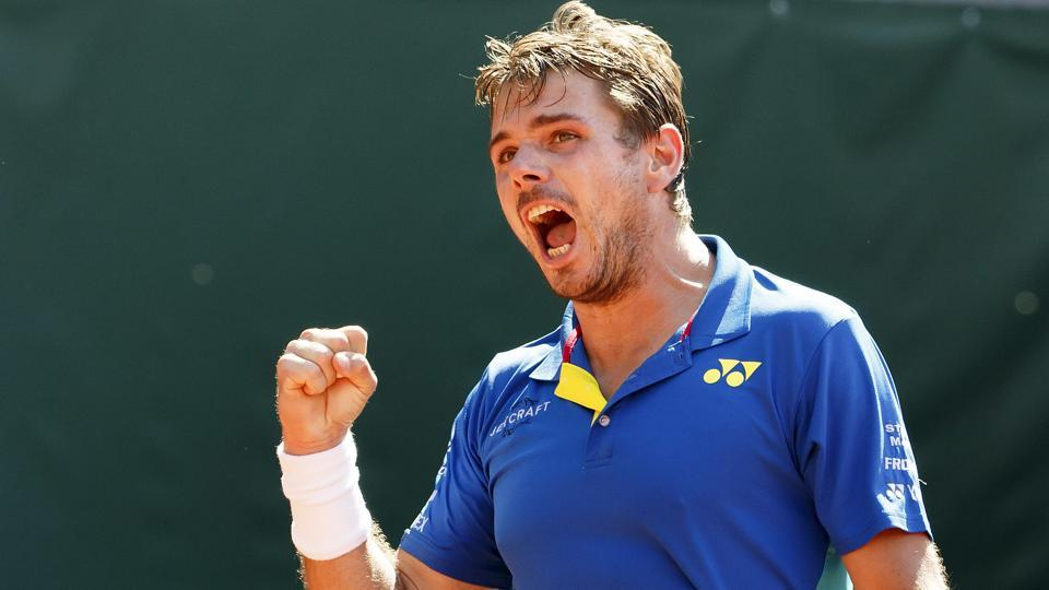 Stan Wawrinka of Switzerland reacts after winning a game against Mischa Zverev of Germany at the Geneva Open.