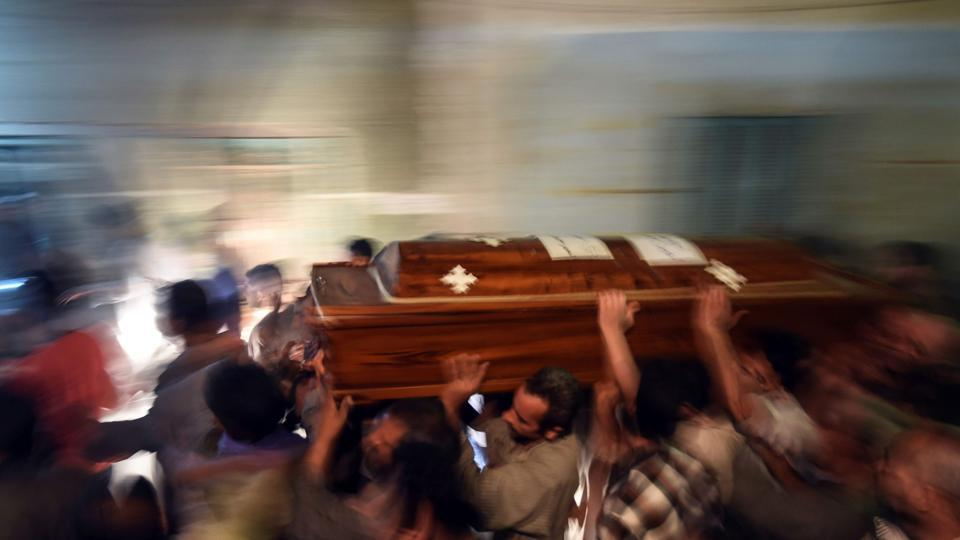 Relatives of killed Coptic Christians carry a coffin as they gather outside the Abu Garnous Cathedral in the north Minya town of Maghagha, on May 26, 2017, during the funeral of the victims.