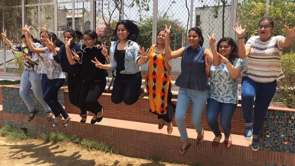 Students celebrate after the CBSE class 12 results were declared in Blue Bells School, sector-4 in Gurgaon.