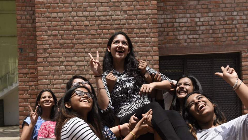 Girls celebrate after seeing their CBSE Class 12th result at St Thomas School, New Delhi.