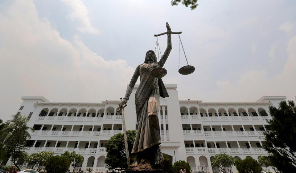 The statue of Lady Justice stands after it was reinstalled near the Supreme Court complex in Dhaka, Bangladesh,  on Sunday.