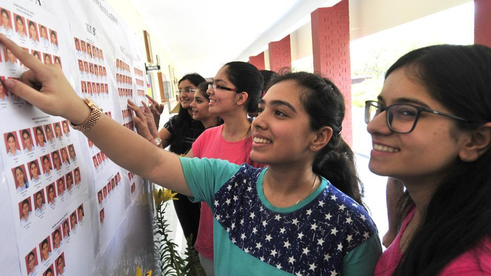 Students of Mount Carmel school, Chandigarh checking  their results on Sunday.
