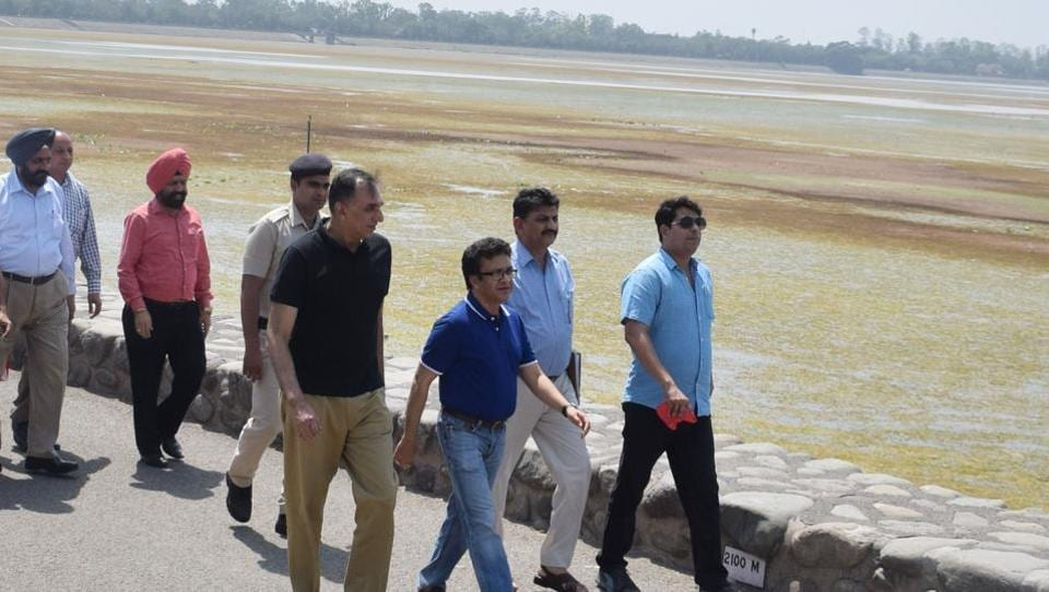 Home secretary Anurag Aggarwal (centre) and other officials inspecting Sukhna Lake.