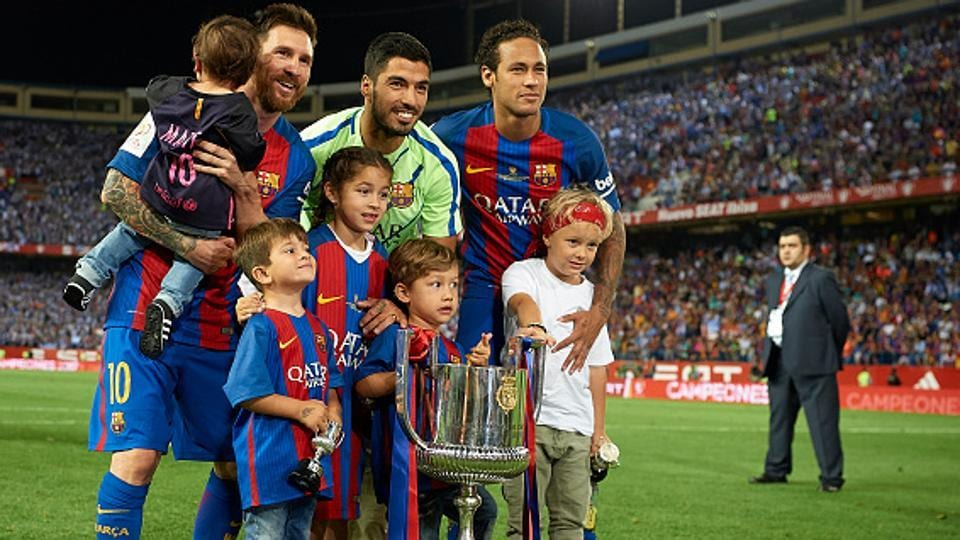 Lionel Messi (L), Luis Suarez and Neymar of FC Barcelona celebrate with their children after winning the Copa del Rey final against Deportivo Alaves at Vicente Calderon stadium on Saturday. With the Cup triumph, Luis Enrique ended his three-year stint as Barca manager with another silverware.