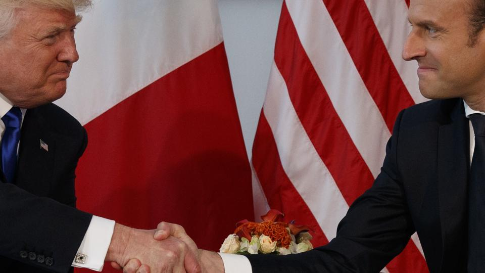 President Donald Trump shakes hands with French President Emmanuel Macron during a meeting at the US Embassy in Brussels on May 25.
