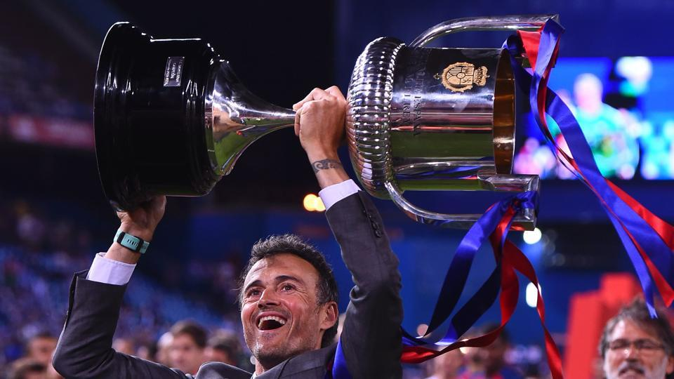 FC Barcelona coach Luis Enrique celebrtes with the Copa del Rey after beating Deportivo Alaves in the final at Vicente Calderon stadium in Madrid on Saturday.