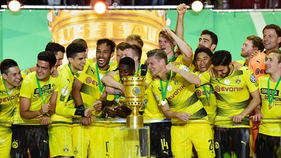 Borussia Dortmund players celebrate with the trophy after winning the German Cup final against Eintracht Frankfurt at the Olympic stadium in Berlin on Saturday.