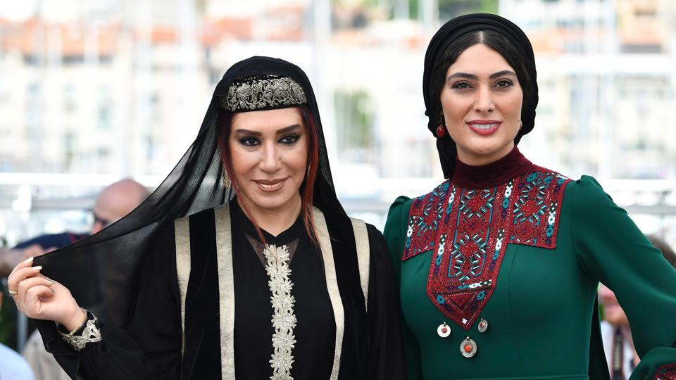 Iranian actors Nasim Adabi (L) and Soudabeh Beizaee pose on May 19, 2017 during a photocall for the film Lerd (A Man of Integrity) at the 70th edition of the Cannes Film Festival in Cannes.