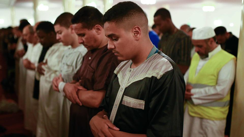 Representative photo. People pray at the Grand Mosque of Saint-Denis, near Paris, on May 27, 2017 in Saint-Denis, outside Paris, on the first day of the holy fasting month of Ramadan.