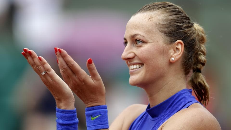 Petra Kvitova of the Czech Republic acknowleges the crowd support after defeating Julia Boserup in the first round of the French Open tennis tournament at Roland Garros on Sunday