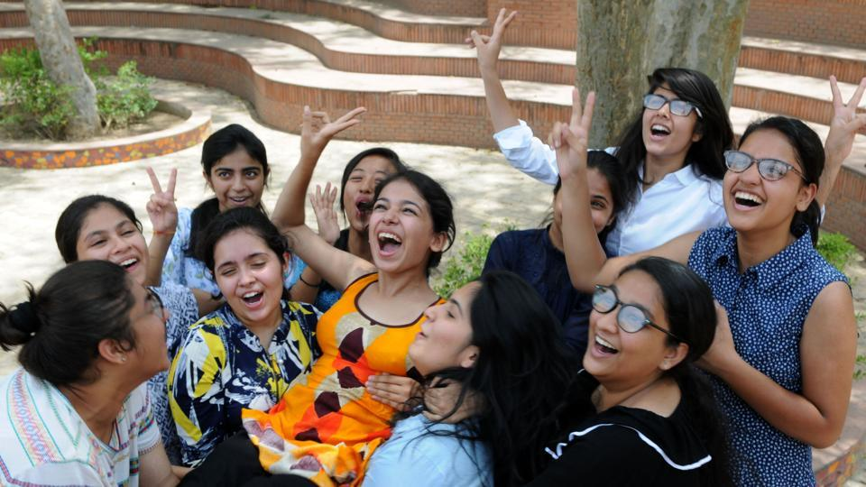 Girls celebrate their success in  the CBSE Class 12 results in Blue Bells Model School, Sector-4, in Gurgaon on Sunday.