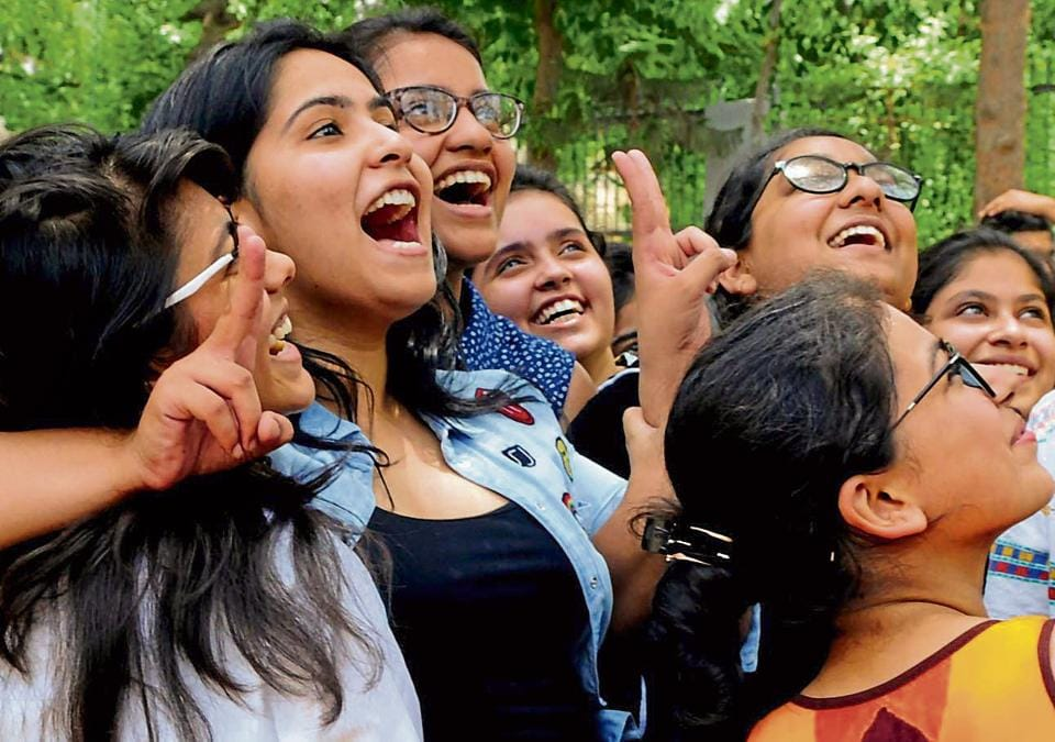 Girls celebrate their success in Gurgaon on Sunday.
