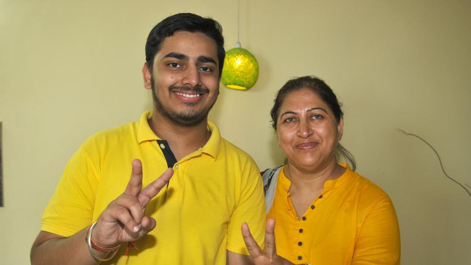 Vithal Bhnadari with his mother