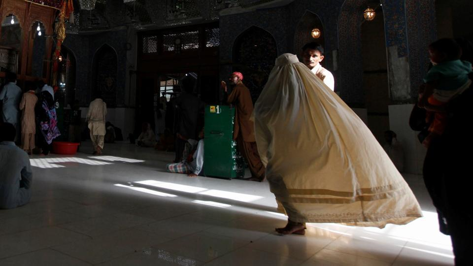 A file photo of woman clad in burqa walking in the hallway of the tomb of Sufi saint in Pakistan.