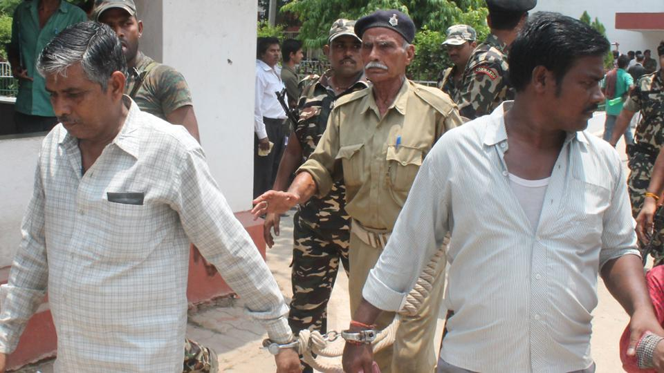 Two of the five convicted Maoists in police custody.