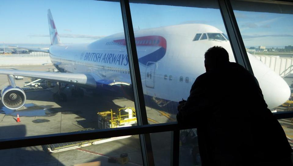A passenger looks at a British Airway flight at John F. Kennedy (JFK) international airport in New York on Saturday.