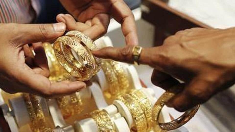 Aman displays gold jewellery.