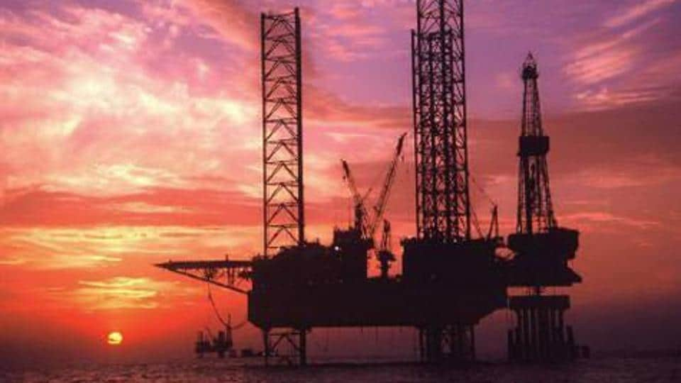 Sunset in the background of an offshore oil drilling platform.