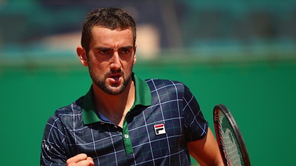 Marin Cilic beat Ernests Gulbis 6-3, 6-3, 6-3 to reach men's singles second round.  (Getty Images)