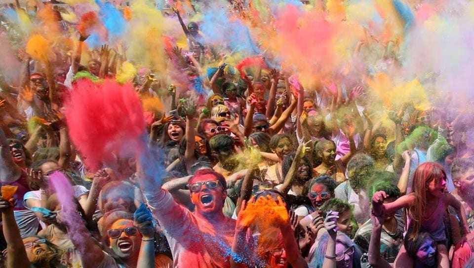 People throw coloured powder during the Holi festival in Santa Coloma de Gramenet, near Barcelona, Spain. The festival is fashioned after the Hindu spring festival Holi, which is mainly celebrated in the north and east of India. (Albert Gea / Reuters)