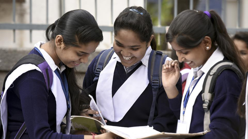 Students revise their lessons before appearing in board exams outside Govt girls senior secondary school in New Delhi.