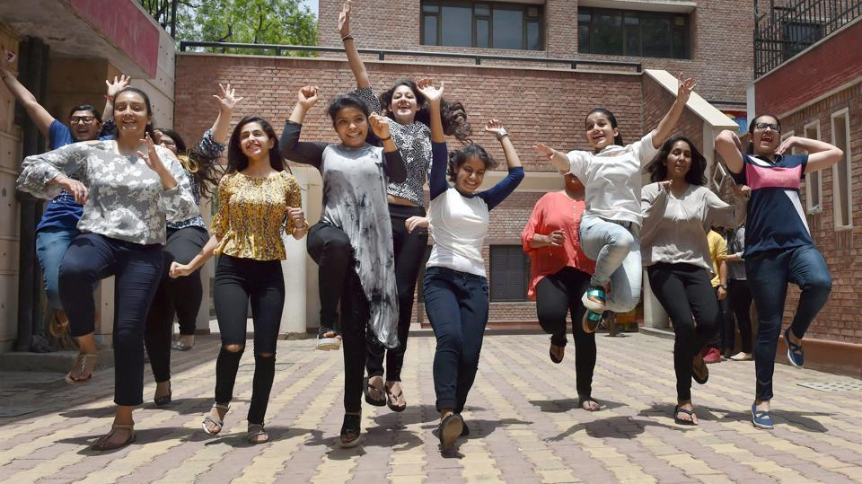 Students celebrate their success in the CBSE class 12th examination at their school in New Delhi on Sunday.