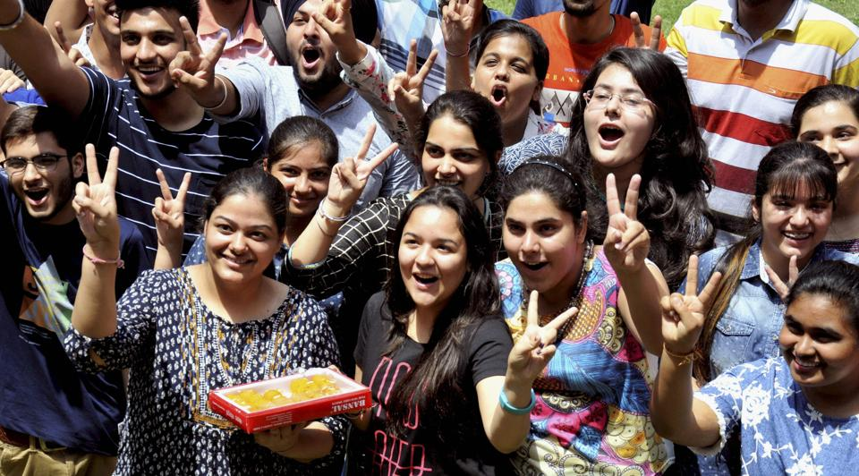 Students celebrate their success after the announcement of CBSE class 12th results on Sunday.