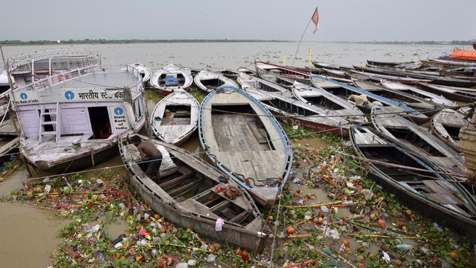 Garbage and water hyacinth floats in the Ganges near boats anchored on Dashashwamedh Ghat in Varanasi. A recent study carried out by a group scientists revealed that the growing pollution in the Ganges has made a drastic change in Nitogen Phosphorous(NP) ratio essential for the growth of naturally growing algae colonies which help in purification. As efforts to review the National River, Ganga Rejuvenation Protection and Maintenance Bill 2017 have been started. It is expected that the Ganga will soon become the first river in the country to be protected by an Act. (Ravi Choudhary/HT PHOTO)