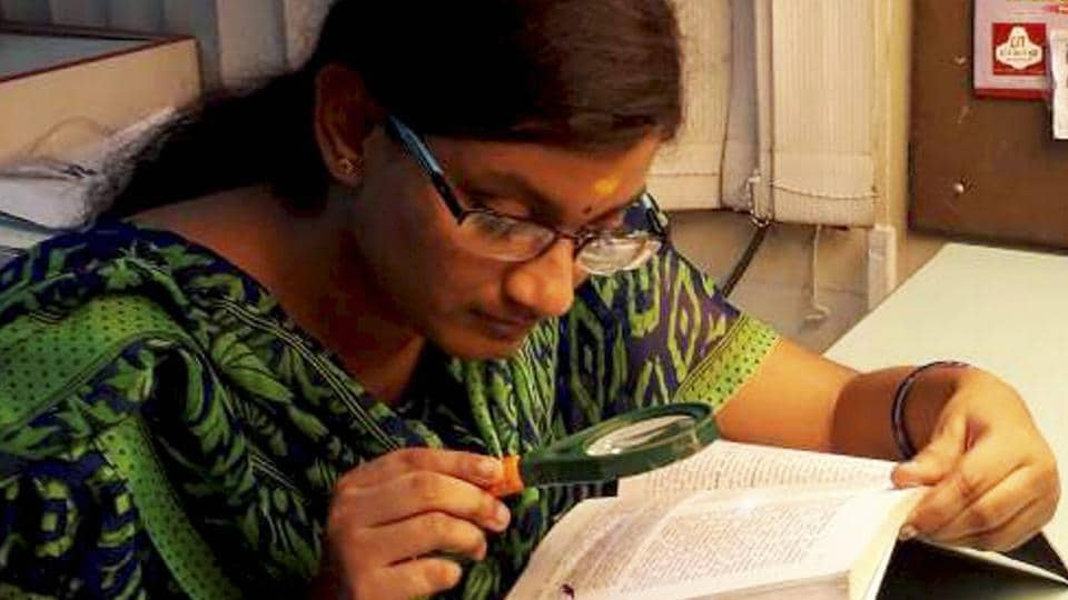 Dharshana MV scored third highest marks in CBSE class XII exams in differently-abled category. Hailing from Krishnagiri in Tamil Nadu, Dharshan, who has almost nil vision in right eye and partial in left, uses magnifying glass to read.  (PTI)