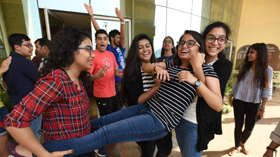 Students of The Shriram Millennium School in Noida celebrate on Monday after receiving ICSE and ISC results.