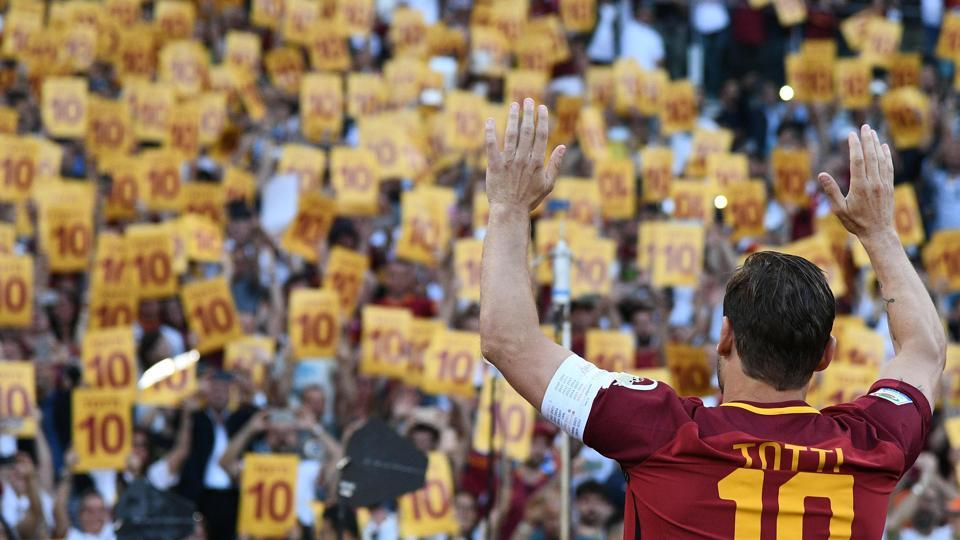 AS Roma's captain Francesco Totti greets fans during the ceremony. (AFP)
