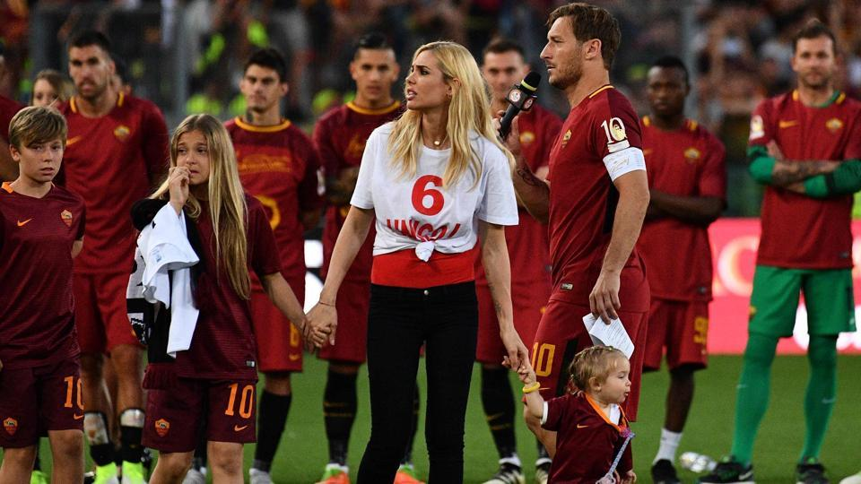 AS Roma's captain Francesco Totti delivers a speech next to his wife Ilary and his children Isabel (R), Chanel and Cristian (L). (AFP)
