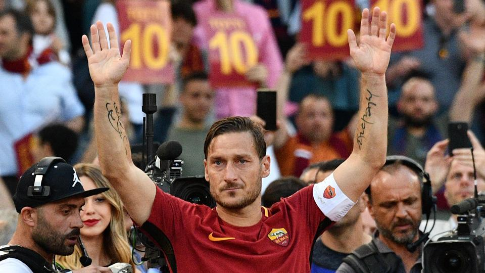 AS Roma's captain Francesco Totti greets fans during a ceremony following his last match.