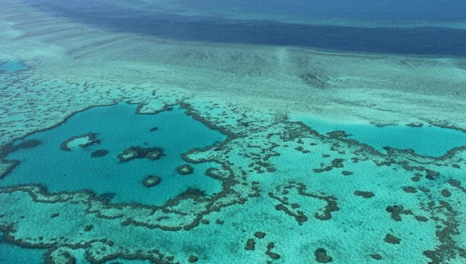 Aerial view of the Great Barrier Reef off the coast of the Whitsunday Islands, along the central coast of Queensland.