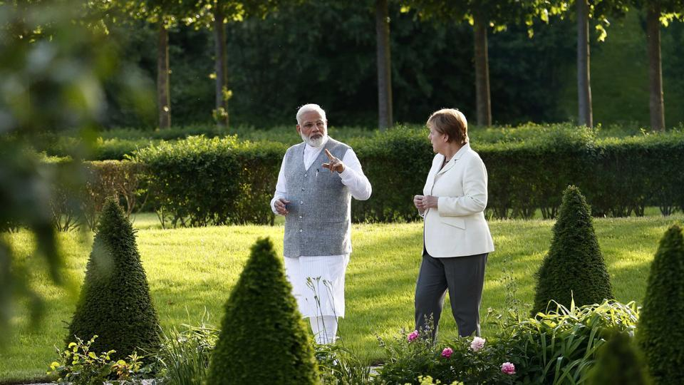 German Chancellor Angela Merkel listens to Indian Prime Minister Narendra Modi during their meeting at the German government guesthouse Meseberg Palace in Meseberg, Germany on May 29.