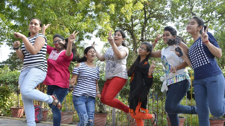 Class 12 students celebrate their results at a school in Ghaziabad on Monday.