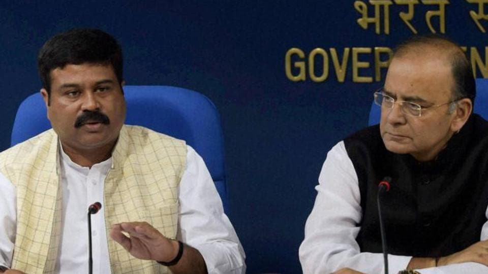 Petroleum minister Dharmendra Pradhan and finance minister Arun Jaitley.